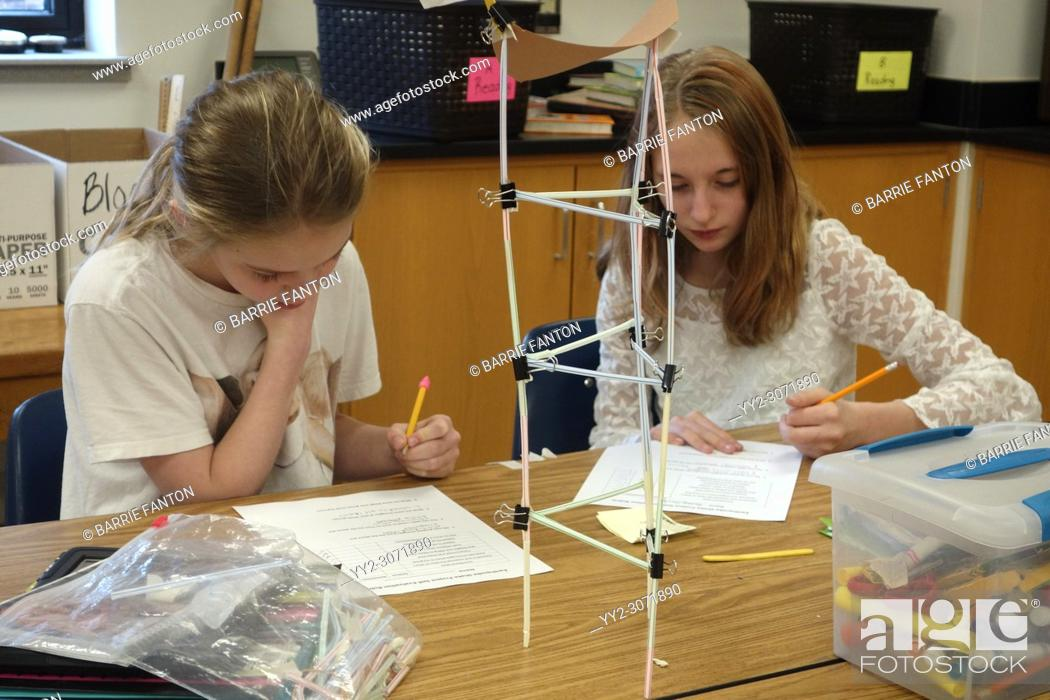 Stock Photo: 6th Grade Girls Building Model of Earthquake Resistant Structure, Wellsville, New York, USA.