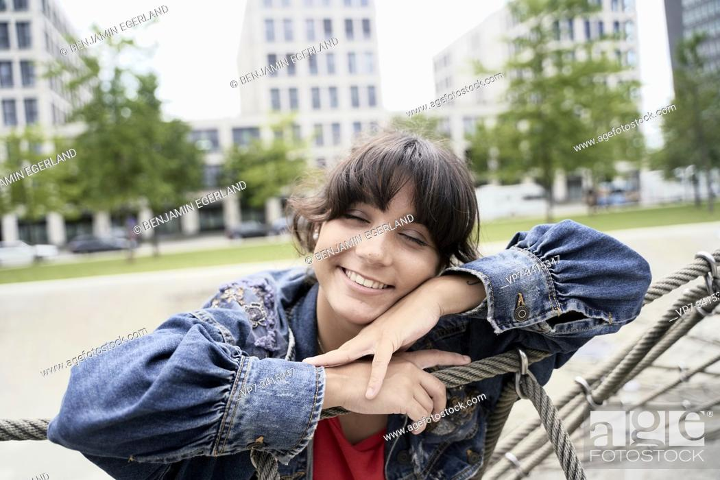 Stock Photo: Young woman in park, Munich, Germany.