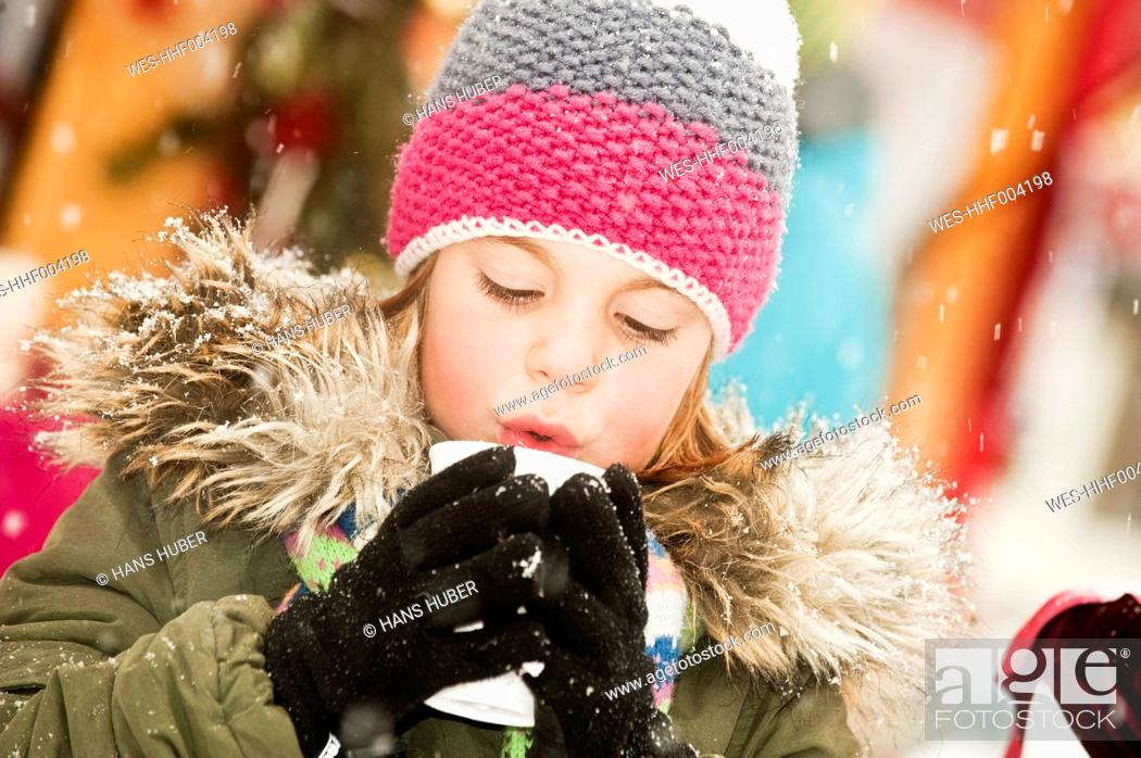 Stock Photo: Austria, Salzburg, Girl with cup at christmas market.