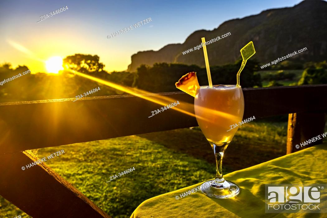 Stock Photo: Coctail at sunset in tropical nature of Vinales, Republic of Cuba, Caribbean, Central America.