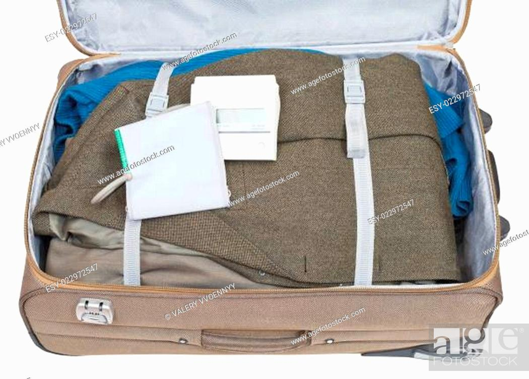 Stock Photo: sphygmometer and jacket packed in suitcase.