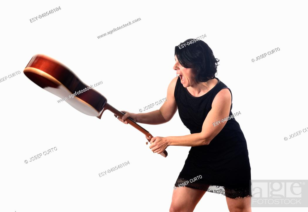 Photo de stock: woman break a guitar.