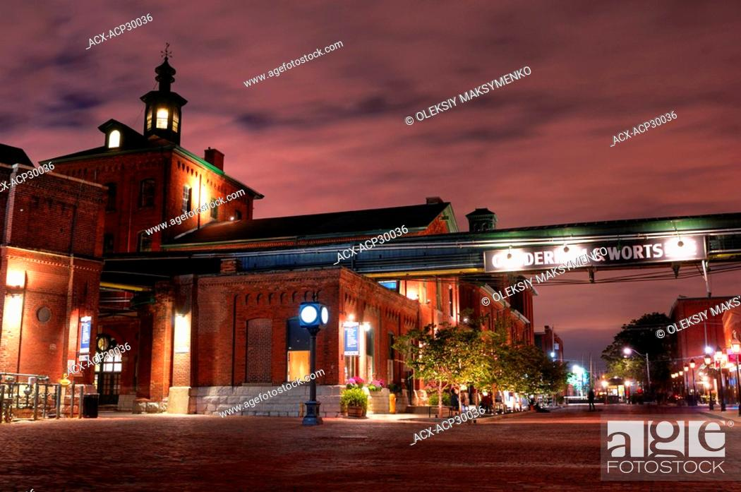 Stock Photo: The Distillery shining at night. Historic district built in 1832 in Toronto Currently one of the major tourist attractions with many shops restaurants and art.