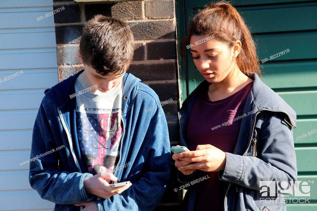 Stock Photo: Teenagers using mobile phones.