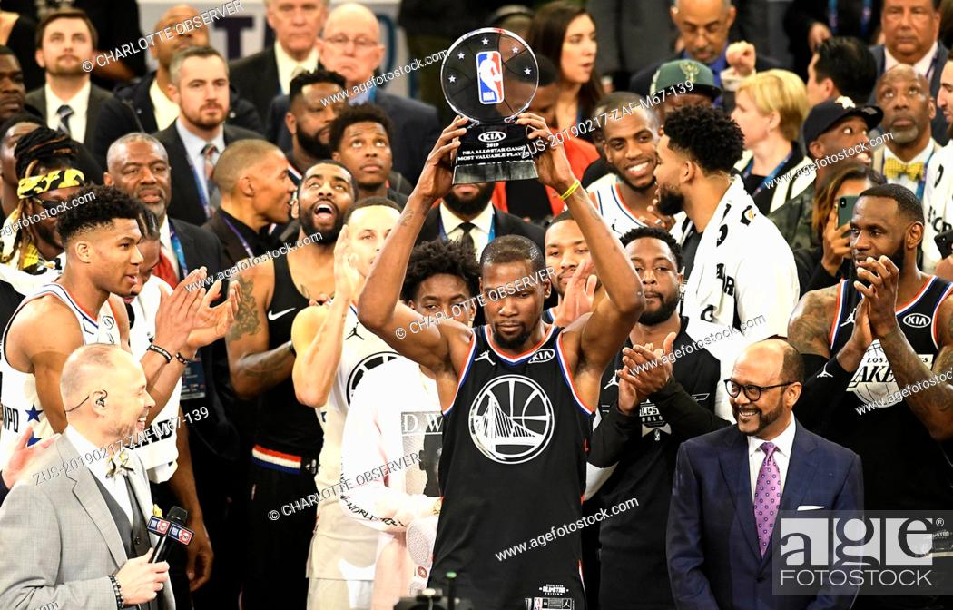 Stock Photo: February 17, 2019 - Charlotte, NC, USA - Team LeBron's Kevin Durant, of the Golden State Warriors, raises the MVP trophy after the 2019 NBA All-Star 2019 game.