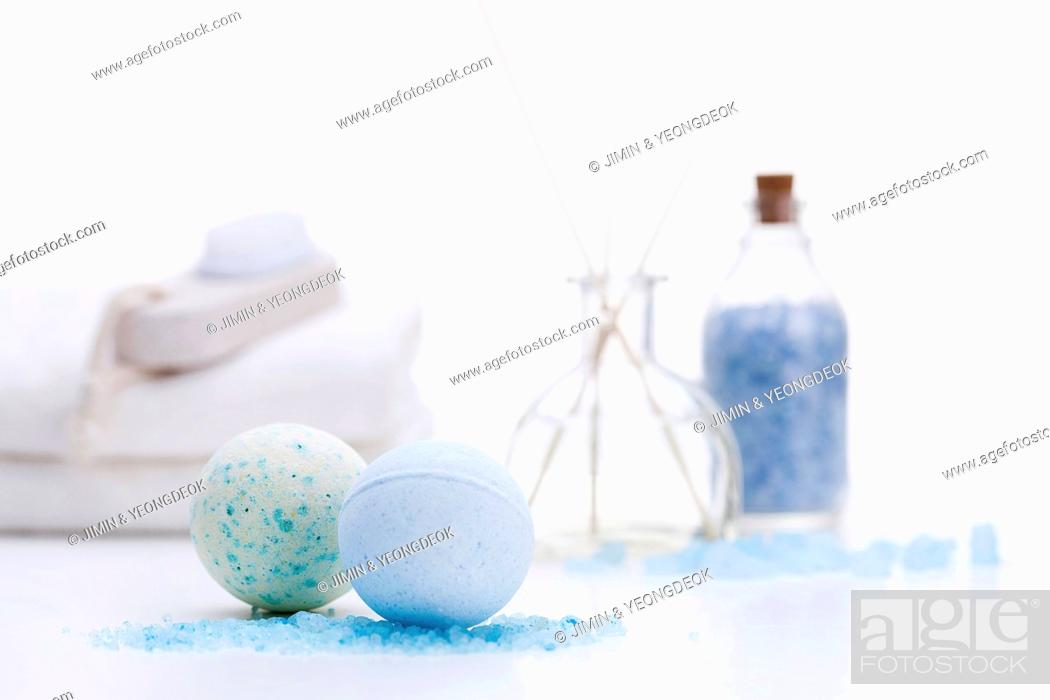 Stock Photo: a bottle of blue powder next to two balls.