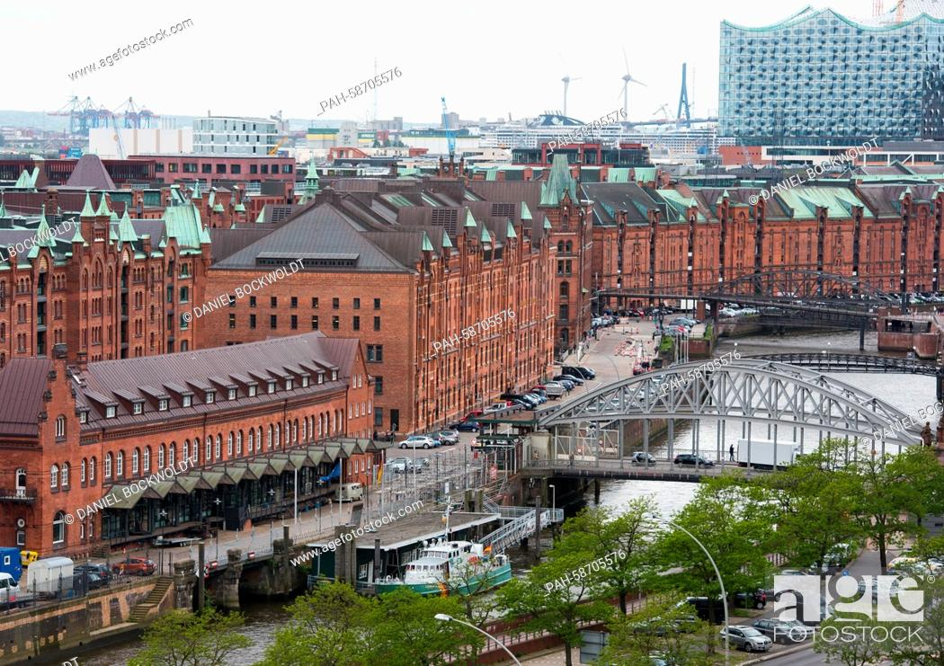 Stock Photo: View onto the roofs of the Speicherstadt and the construction site of the Elbe Philharmonic Hall in Hamburg, Germany, 27 May 2015.