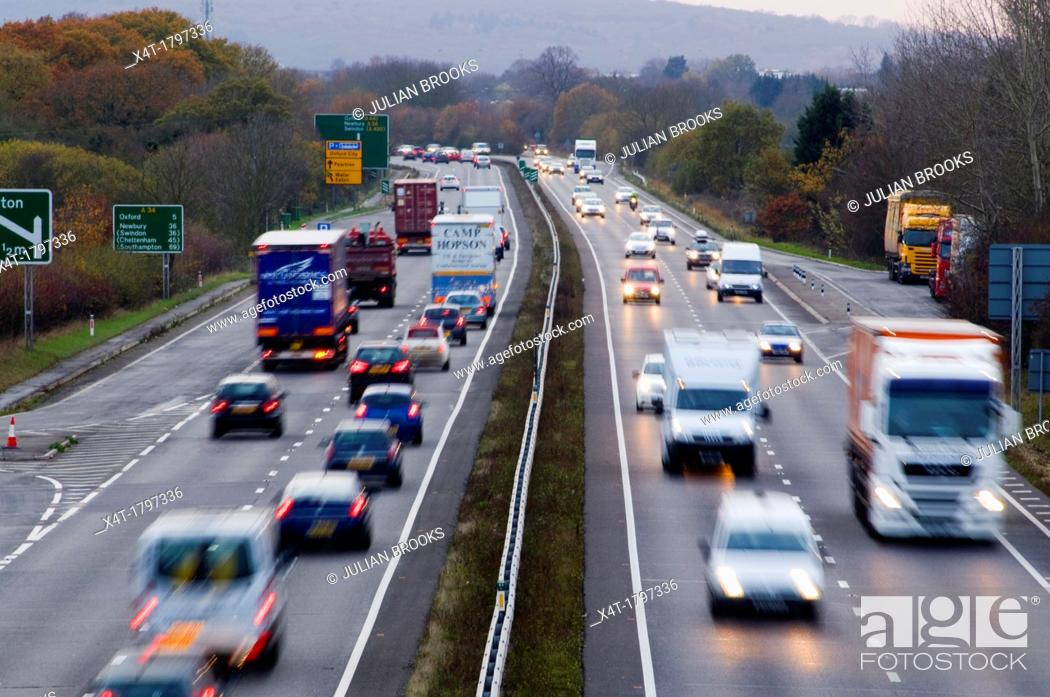 Stock Photo: busy traffic at dusk on the A34.
