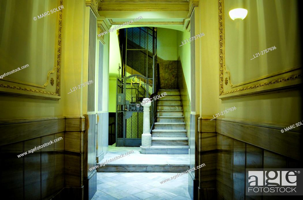 Stock Photo: Entrance of a building apartment, corridor, elevator and stairs. Barcelona, Catalonia, Spain.