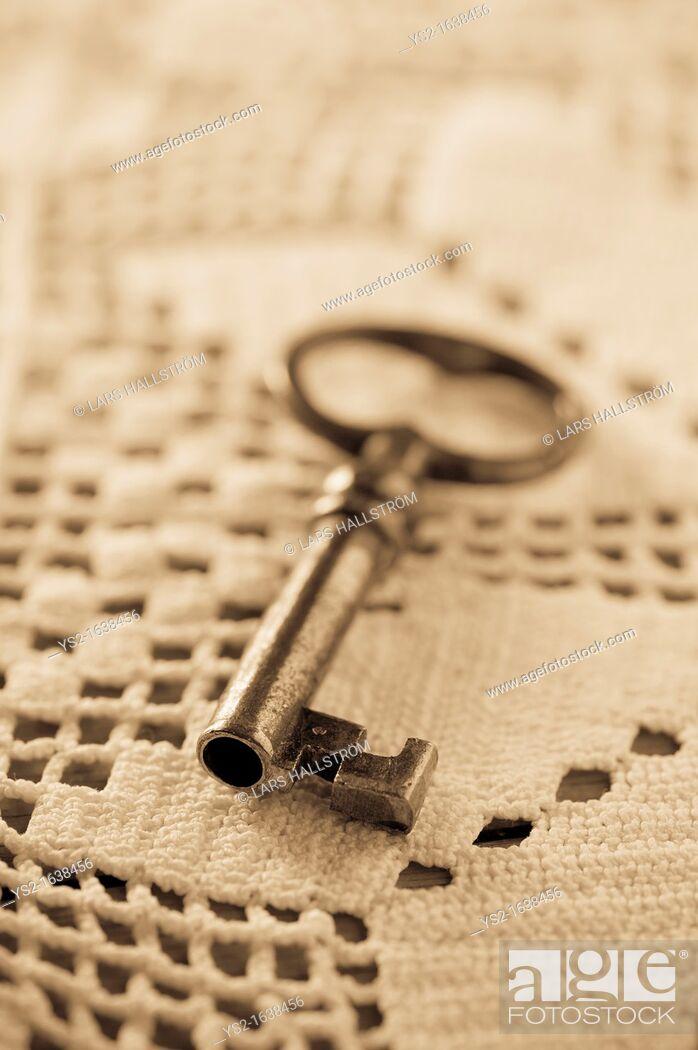 Stock Photo: Key lying on tablecloth.