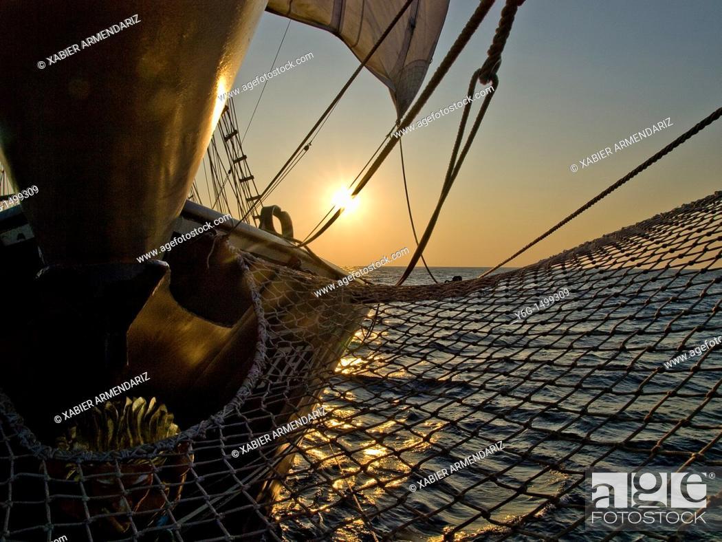 Stock Photo: Bergantin Thalassa sailing at sunset.