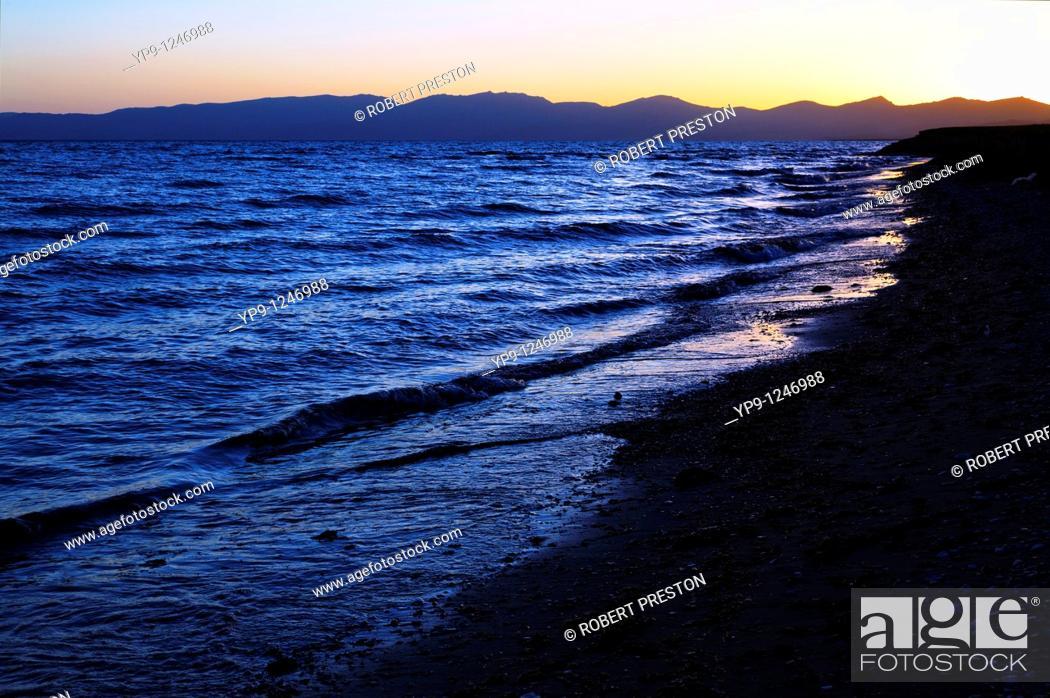Stock Photo: Kyrgyzstan - Lake Song Kul - sunset over the mountains surrounding Lake Song Kul.