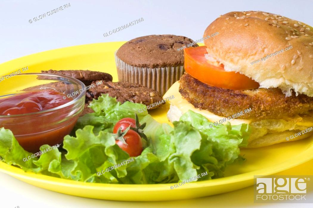 Stock Photo: Close-up of lettuce salad with a hamburger.