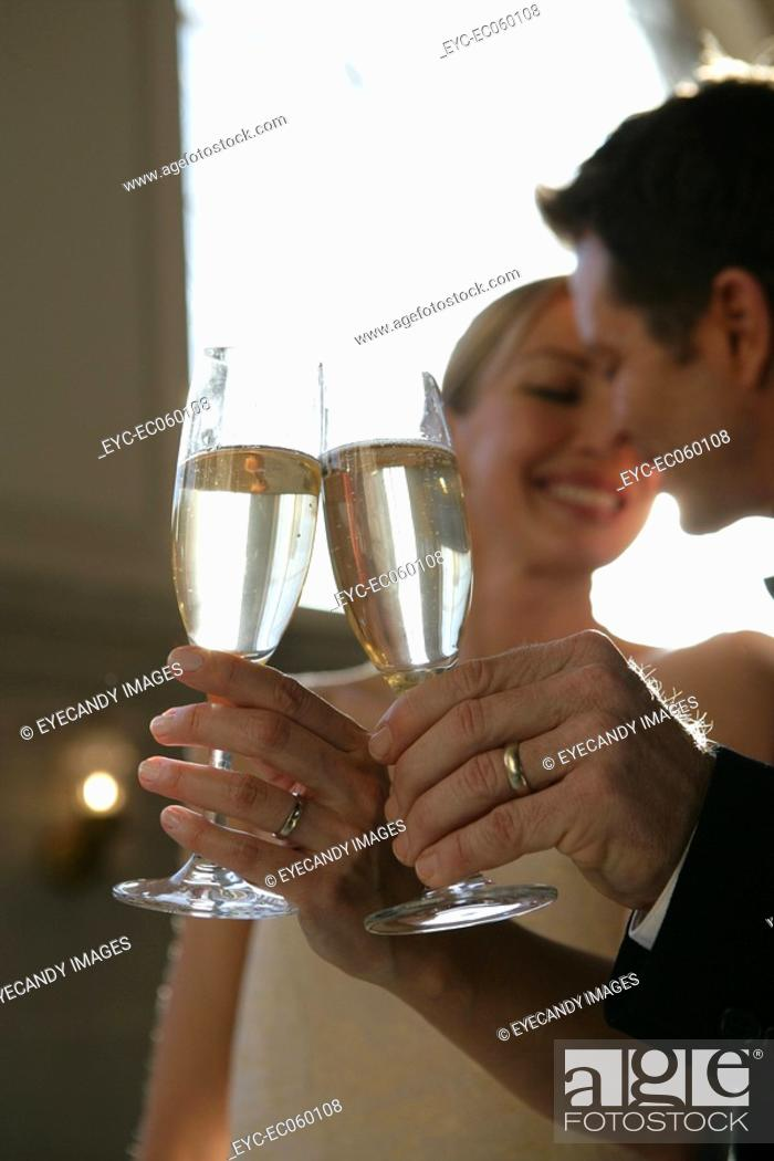 Stock Photo: Mature married couple toasting with champagne.