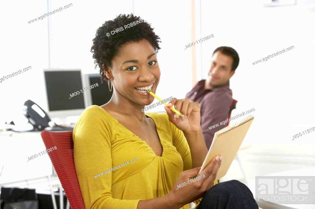 Stock Photo: Two business colleagues in office smiling portrait.