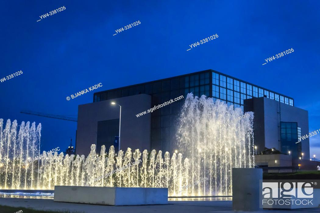 Stock Photo: National and University Library at night and fountains in the Park of Fountains at the avenue of Hrvatske Bratske Zajednice, Zagreb, Croatia.