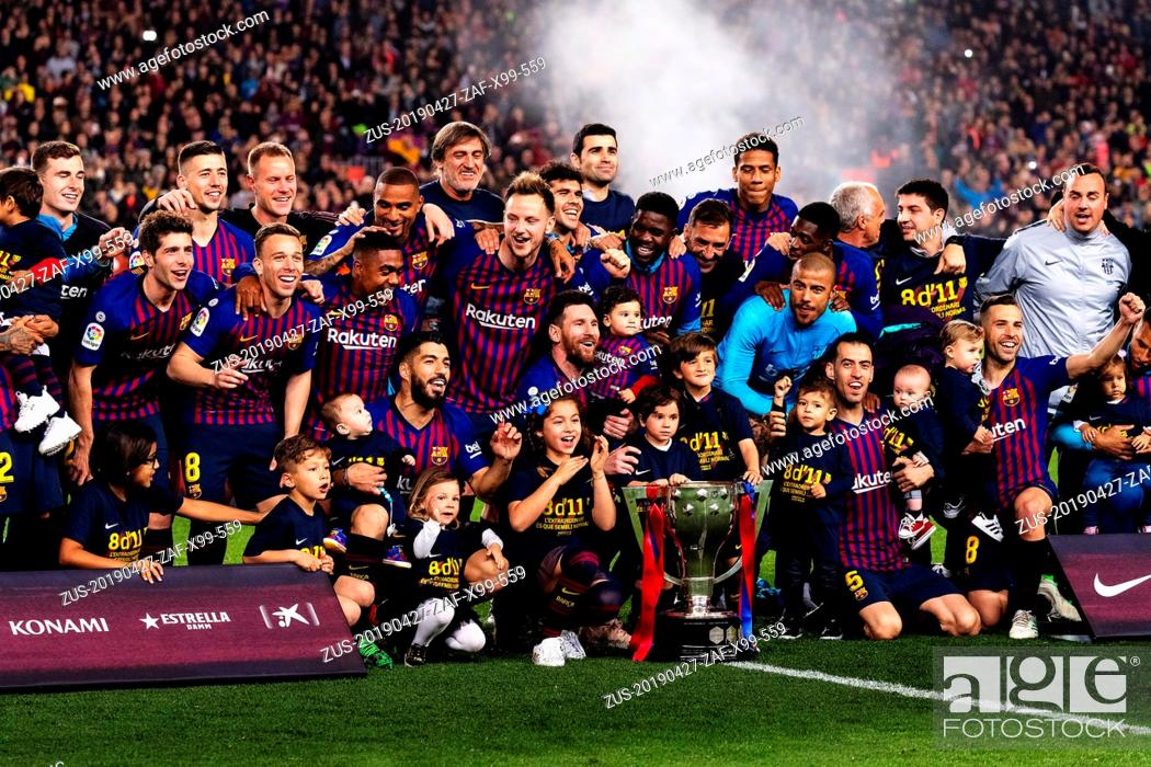 Stock Photo: BARCELONA, April 28, 2019 Barcelona's players celebrate with the trophy after a Spanish league soccer match between FC Barcelona and Levante in Barcelona, Spain.