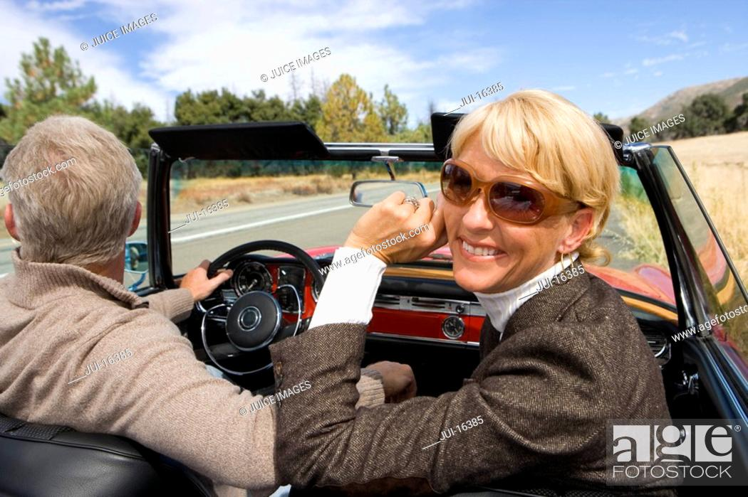 Stock Photo: Couple on road trip in convertible.