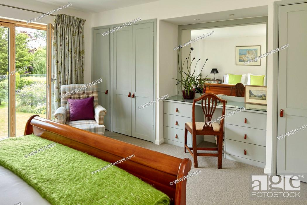 Stock Photo Bedroom Dressing Table Built In With Mirror Reflecting Sleigh Bed And Window Mill Race House Hungerford United Kingdom