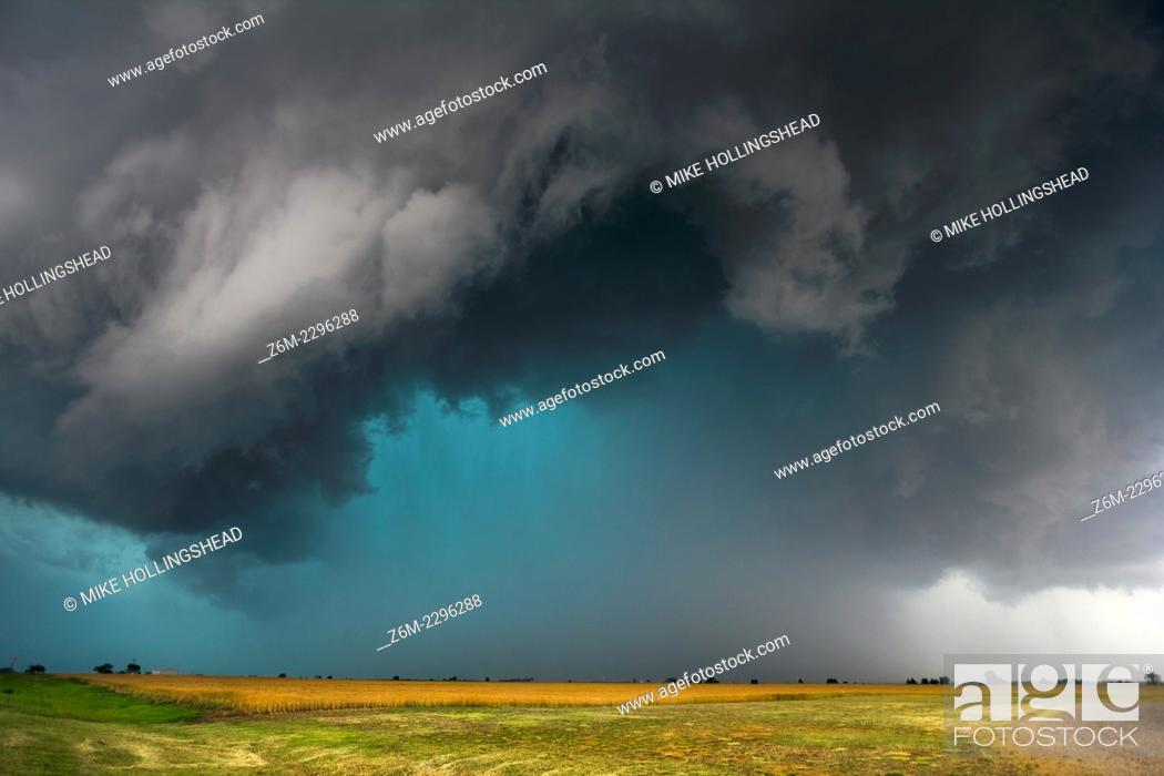 Stock Photo: Supercell producing large hail moves over Meno Oklahoma.