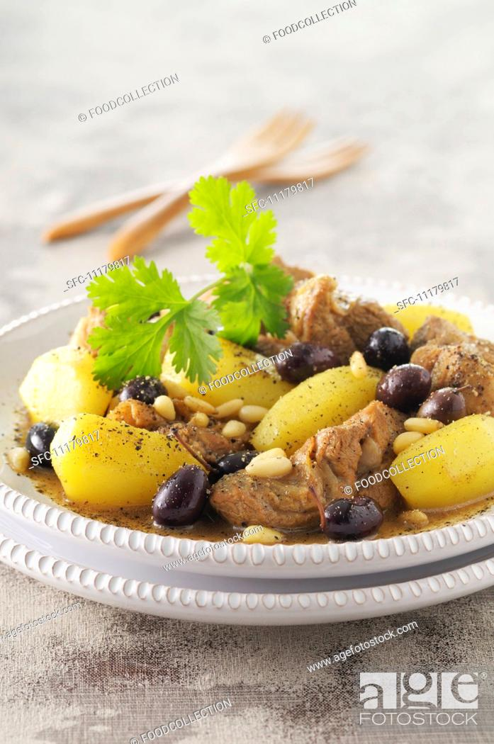 Stock Photo: Lamb tagine with potatoes, olives and pine nuts.