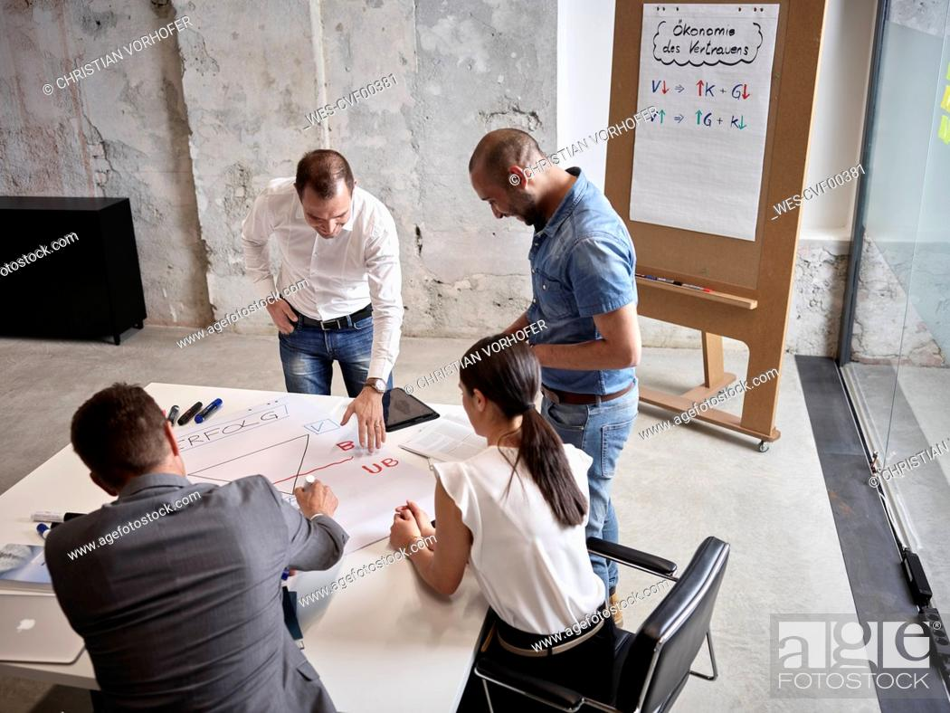 Stock Photo: Business people having a meeting in conference room.