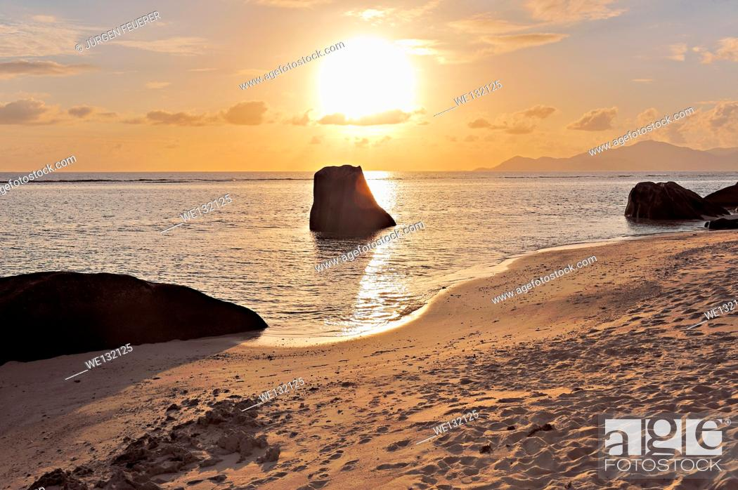 Stock Photo: Sunset on the beach at Source d'Argent, La Digue, Seychelles.