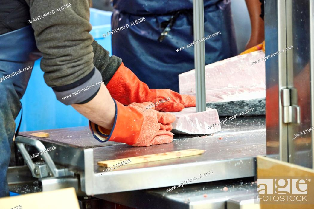 Stock Photo: Cutting frozen tuna at Tsukiji Fish Market. Chuo Ward. Tokyo. Japan.