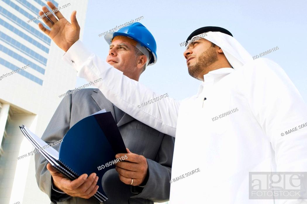 Stock Photo: An architect and a middle eastern businessman.