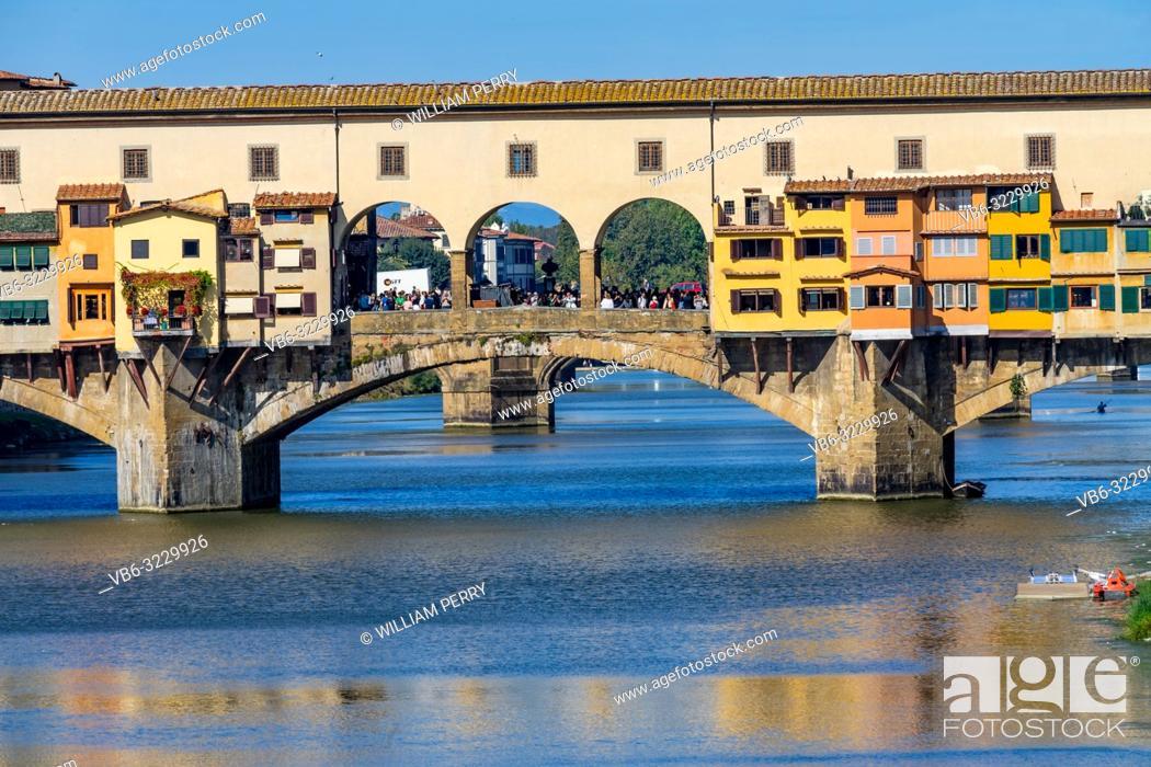 Imagen: Ponte Vecchio Bridge Reflections Arno River Florence Tuscany Italy. Bridge originally built in Roman times, rebuilt in 1345.