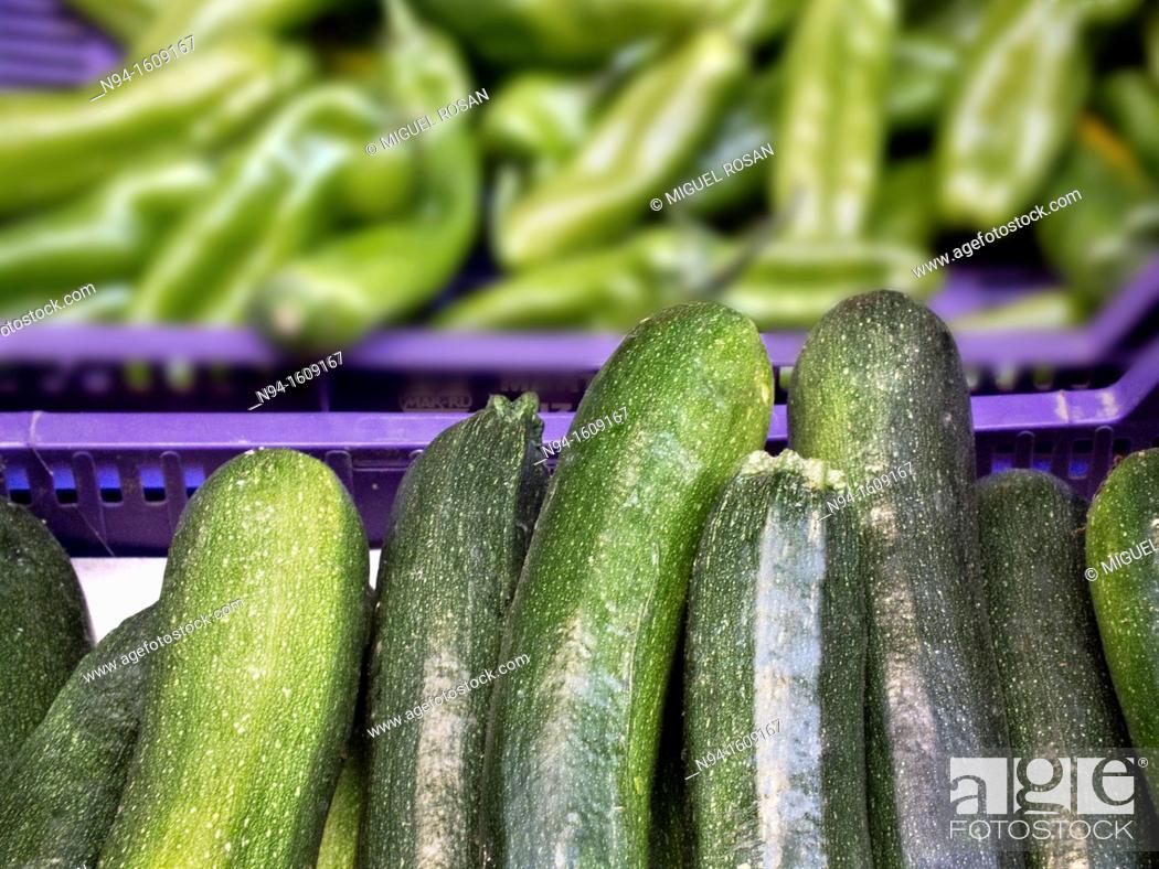 Stock Photo: Boxes of vegetables with zucchini and green peppers.