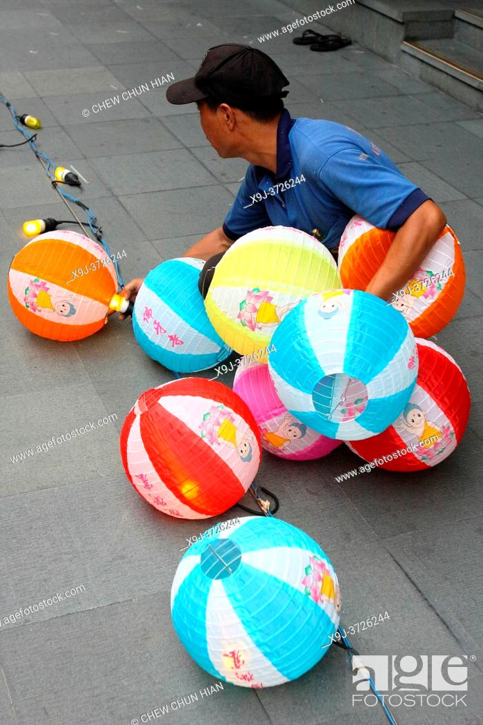 Stock Photo: Worker prepair to hanging paper lantern in the chinese temple, singapore.