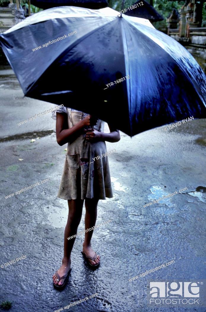 Stock Photo: Indonesia, Bali, Girl in Rain.