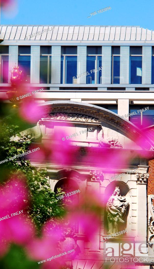 Stock Photo: View of the London Stock Exchange seen across the 17th century Temple Bar Gate and some flowers on a sunny Summers day.