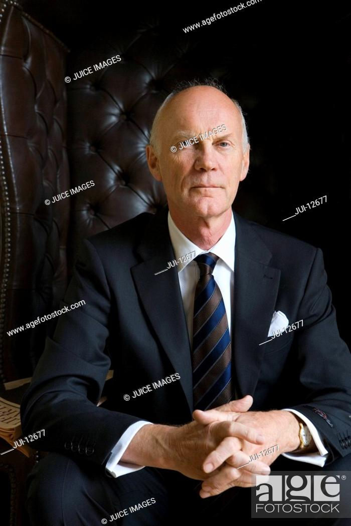 Stock Photo: Senior man in armchair, portrait.