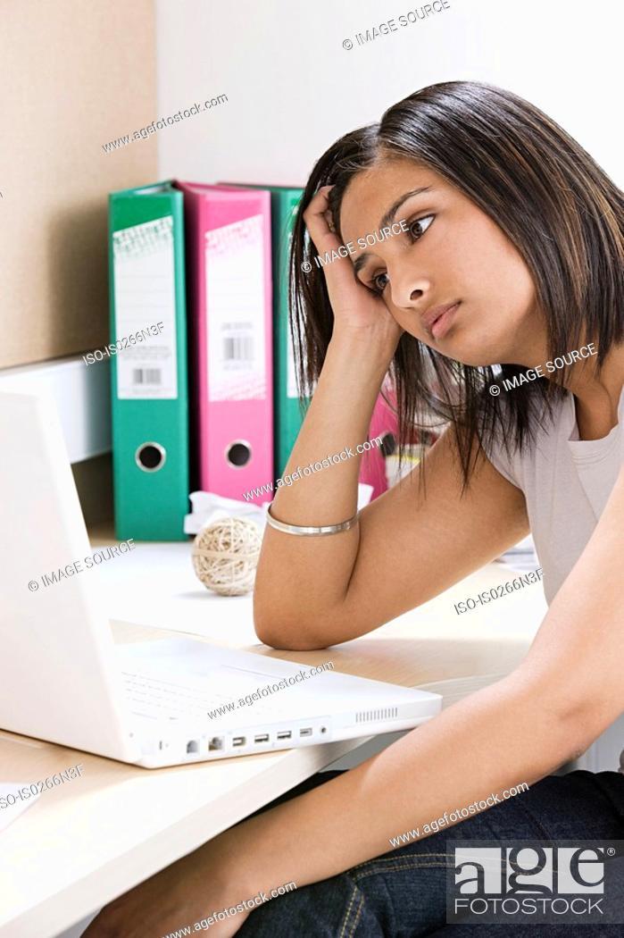 Stock Photo: Female student worrying.