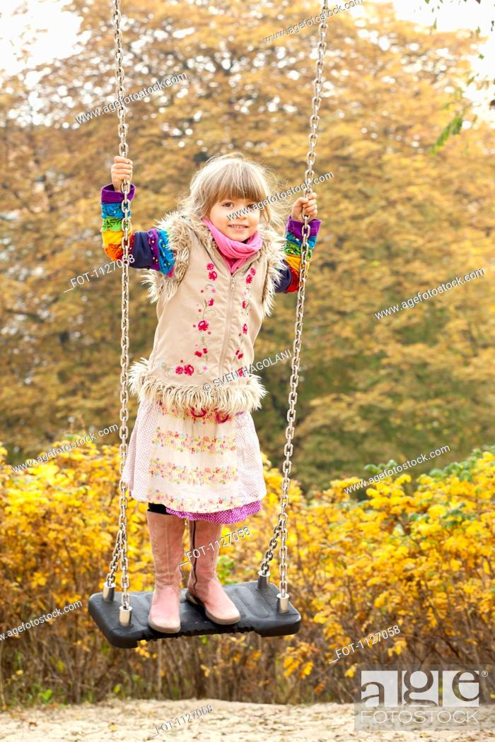 Stock Photo: Girl on swing in park.