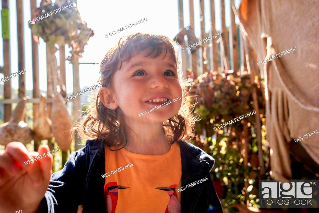 Stock Photo: Portrait of happy toddler girl at backlight.