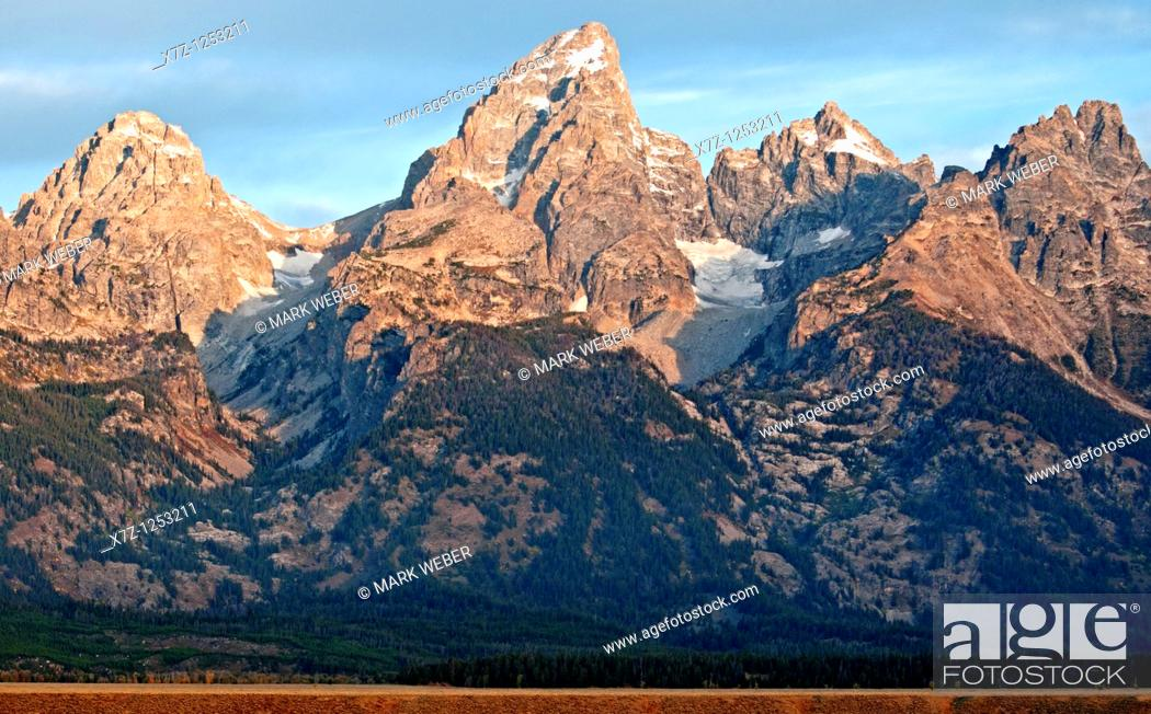 Stock Photo: Tetons, sunrise on The Tetons from Glacier View Overlook at Grand Teton National Park in northern Wyoming.