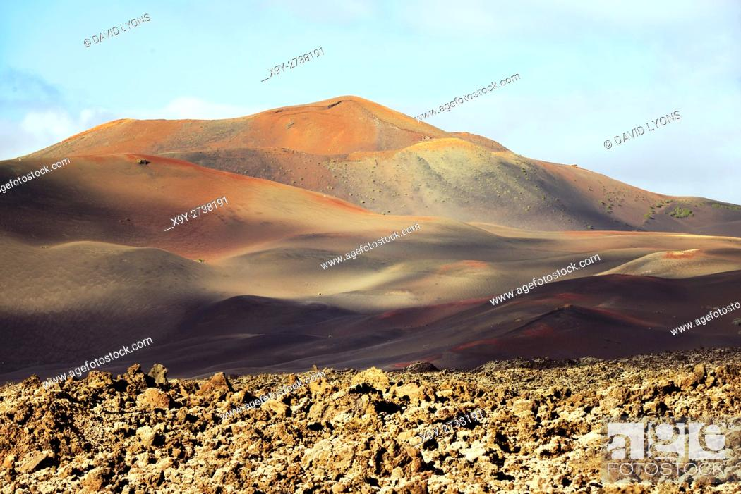 Stock Photo: Volcano cones and lava cinder fields of Timanfaya National Park, Lanzarote, Canary Islands. North from LZ-67 Lava Road near Uga.