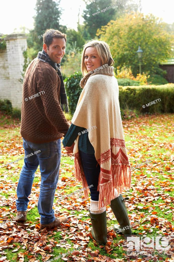 Stock Photo: Couple holding hands outdoors.