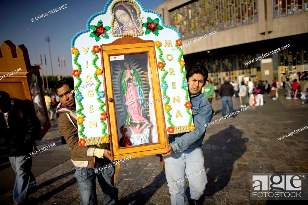 Stock Photo: Pilgrims carry an image of the Our Lady of Guadalupe in Mexico City, December 6, 2008  Hundreds of thousands of Mexican pilgrims converged on the Our Lady of.
