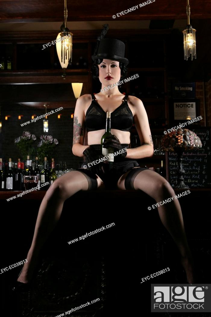 Stock Photo: Young sexy woman in burlesque bar.