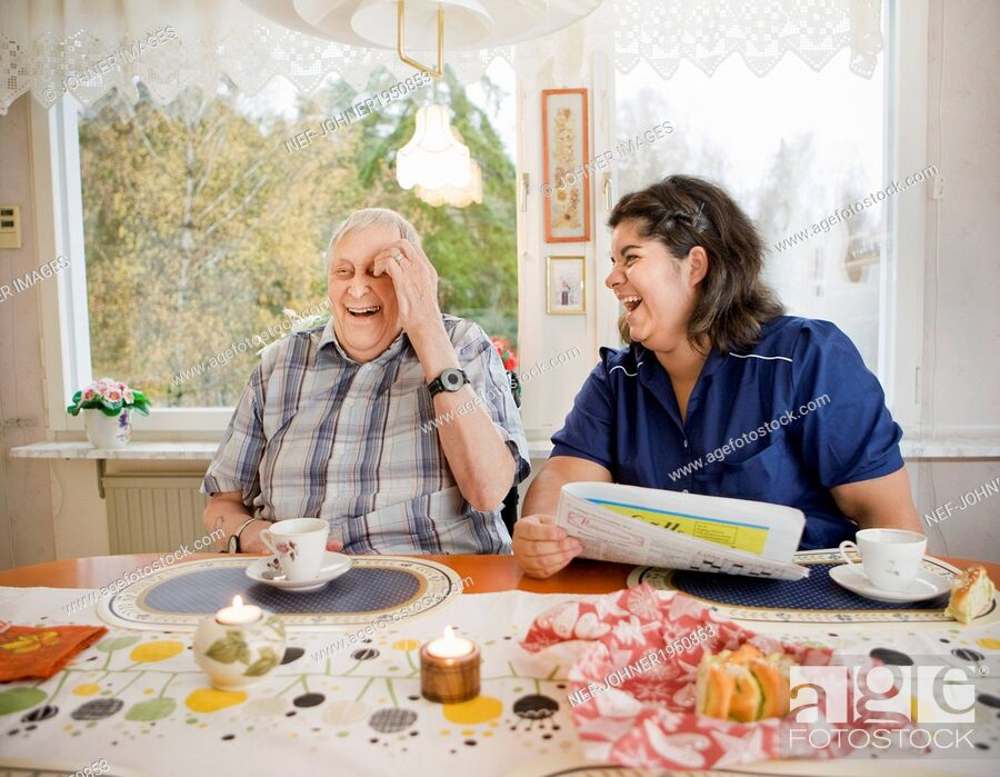 Stock Photo: Nurse with senior man at table, Sweden.