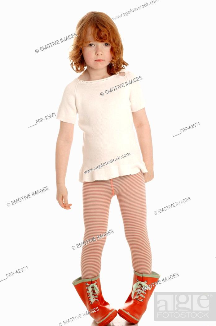 Stock Photo: Red haired child with red rubber boots.