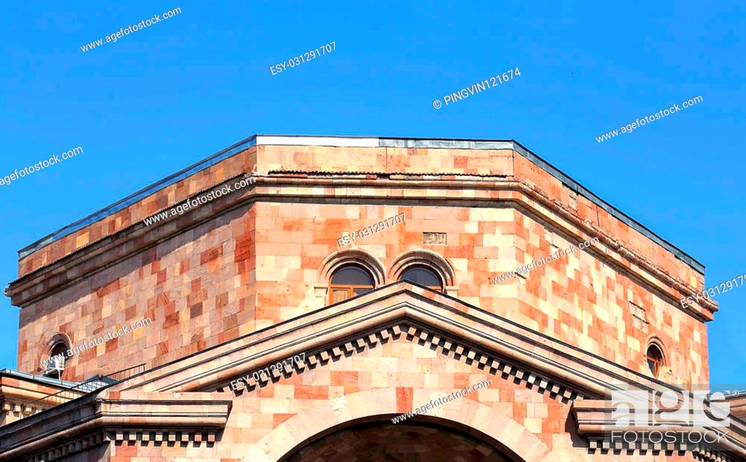 Stock Photo: Top of the huge red building built in a national armenian style.