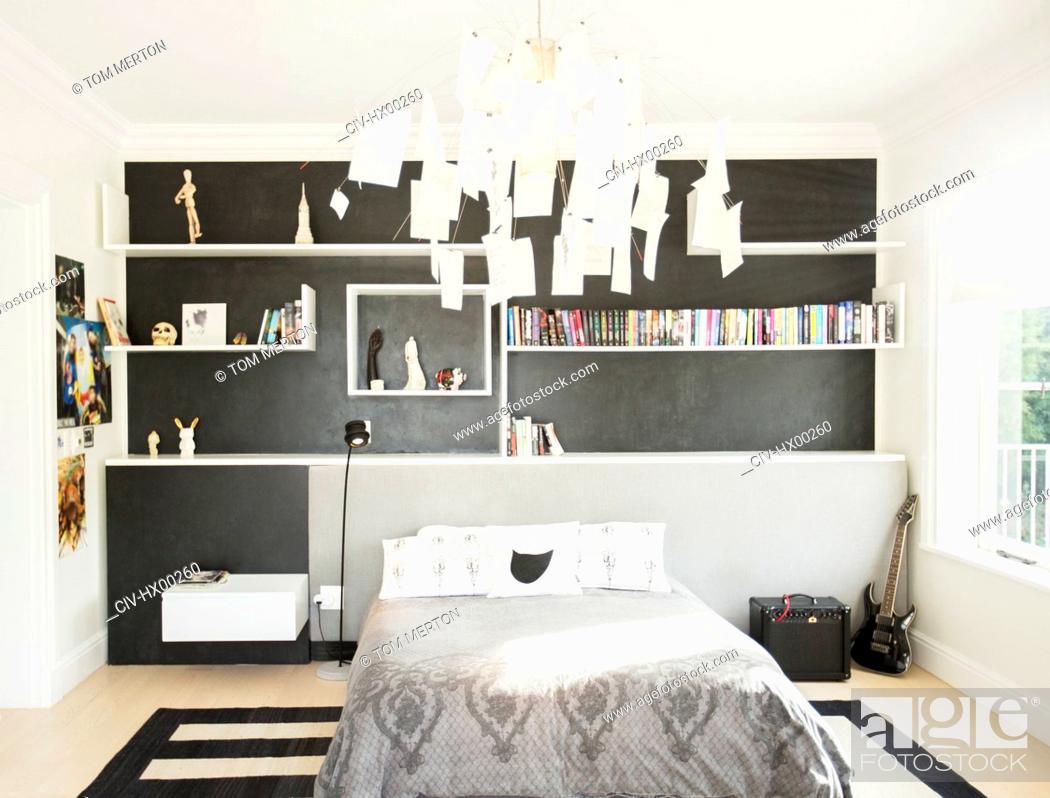 Stock Photo: Modern paper chandelier hanging over bed in bedroom.