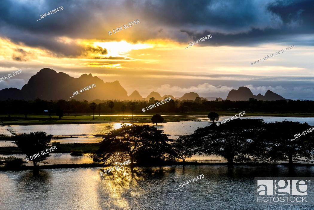 Stock Photo: Sunset above tower karst mountains, artificial lake, landscape in the evening light, Hpa-an, Karen or Kayin State, Myanmar.