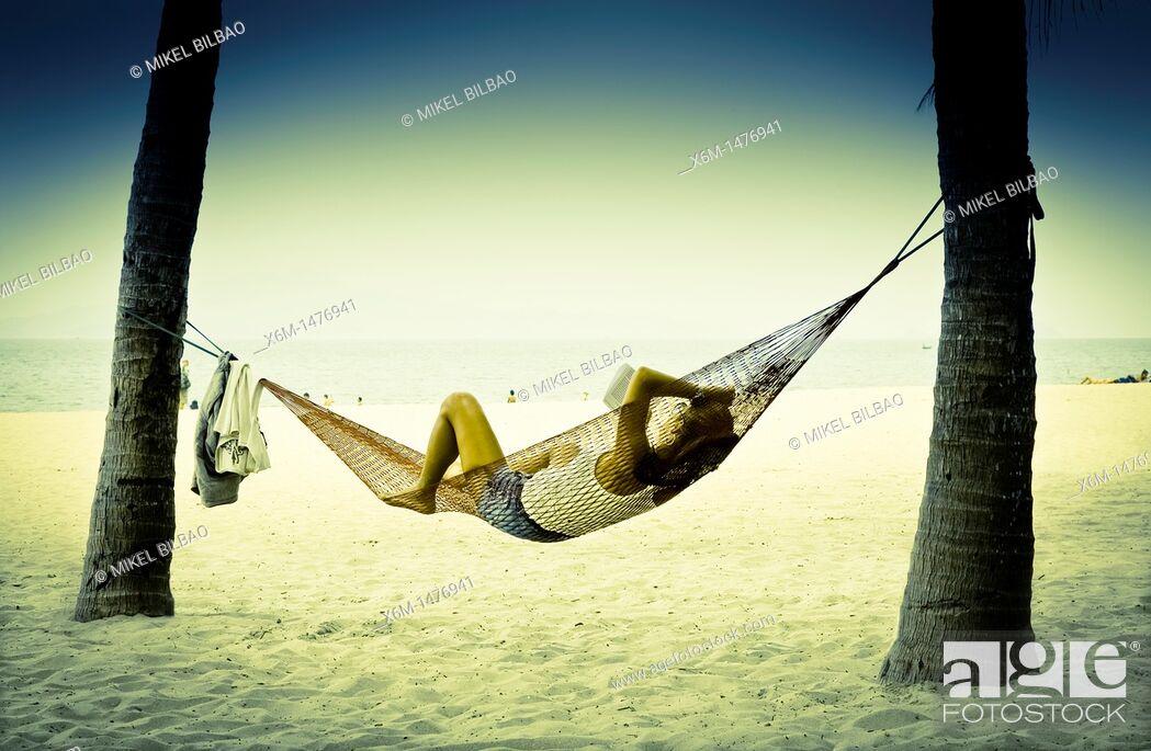Stock Photo: people resting on a hammock  Cua Dai beach  Hoi An, Vietnam, Asia.