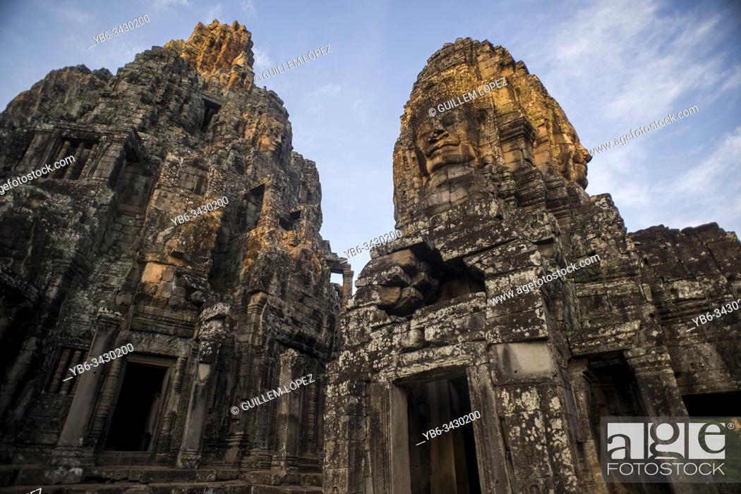Stock Photo: Stone heads at Bayon, Angkor Thom temple, Angkor Wat complex, Siem Reap, Cambodia.